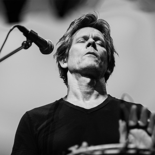 Kevin Bacon plays percussion