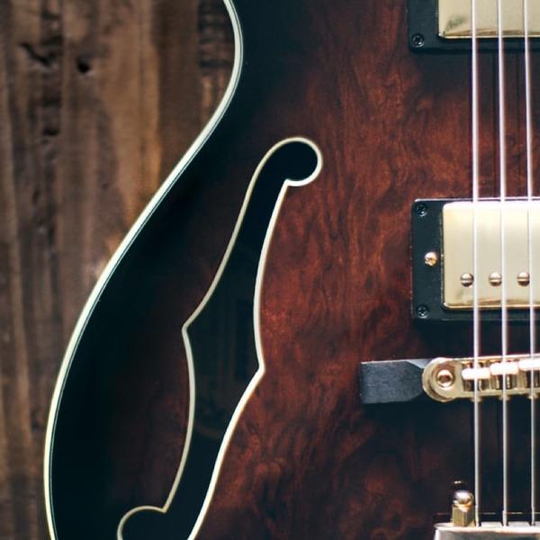 Guitar - Photo by Thomas Kelley on Unsplash